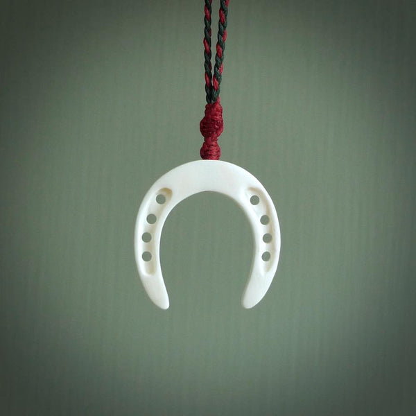 This little pendant is a bone horseshoe we've handcarved for all the horse lovers out there. Free postage worldwide. Bone horseshoe jewellery.