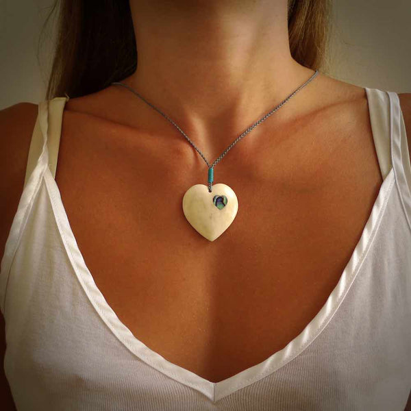 HAND CARVED HEART PENDANT. CARVED FROM BONE. PAUA HEART INSERT. HAND MADE BY NZ PACIFIC. HANDMADE JEWELLERY FOR SALE ONLINE.