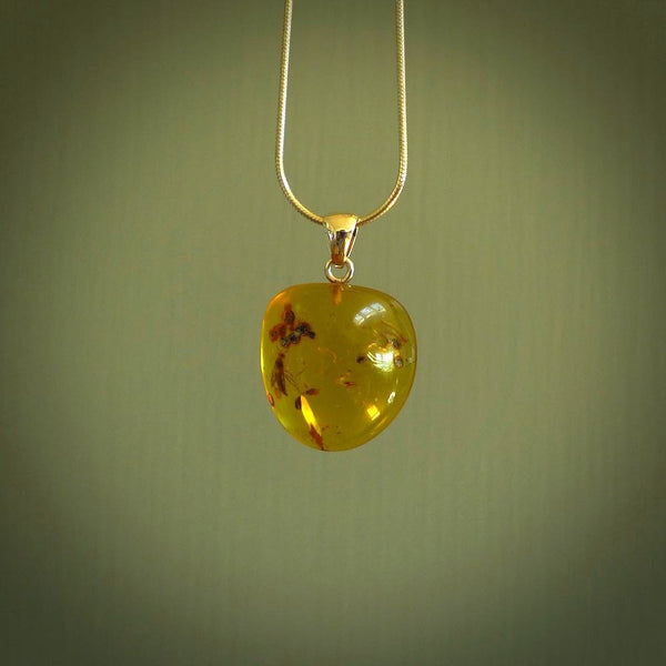 A beautiful, small pendant handmade from Burmese Amber - known as burmite. This material is around 100 million years old and makes a lovely light and rare piece of jewellery.