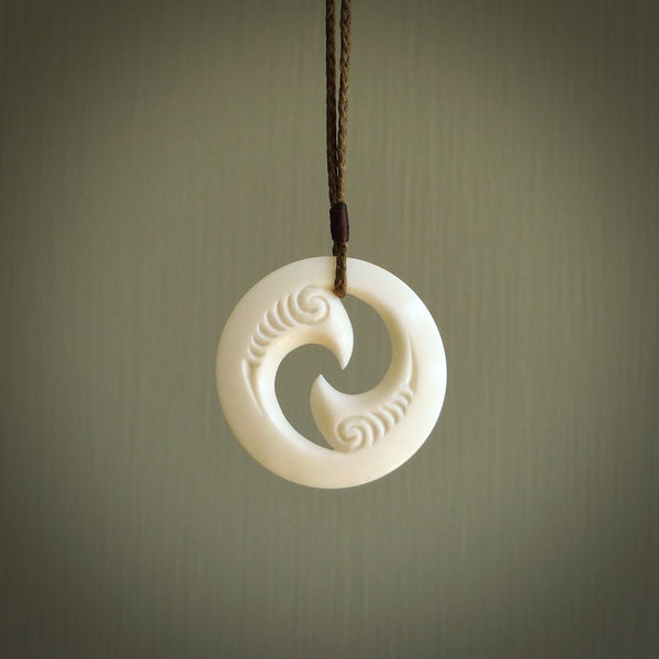 A hand carved and engraved koru pendant carved for us by Yuri Terenyi. These are beautiful little pieces are emblematic of the well known and loved Koru design.