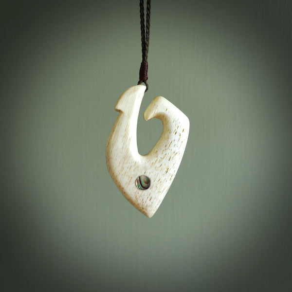 Hand carved whalebone hook pendant. Handmade matau necklace carved from whalebone. Made in New Zealand and for sale online at NZ Pacific.