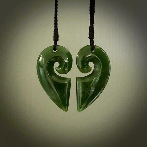 Hand carved double koru pendant. Made from New Zealand Jade. Jade jewellery for sale online.