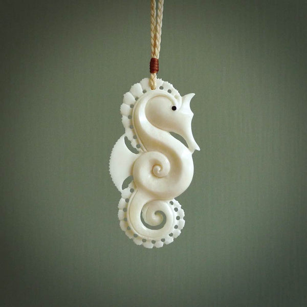Hand carved bone seahorse pendant. Made from natural bone.bone koru style pendant. Made from natural bone. Made by NZ Pacific and for sale online. Moana themed jewellery.