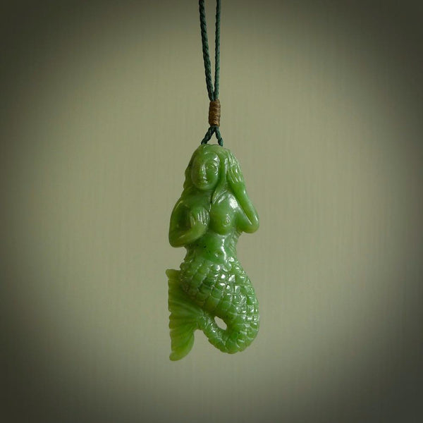 A beautifully carved jade mermaid pendant. The jade is a lovely bright green and these pieces are carved in intricate detail. We ship these free worldwide and provide them with a hand plaited and length adjustable cord.