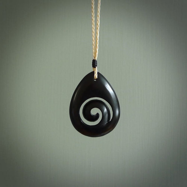 Hand carved koru drop pendant. Made by NZ Pacific in Australian black jade. A beautiful black jade necklace.