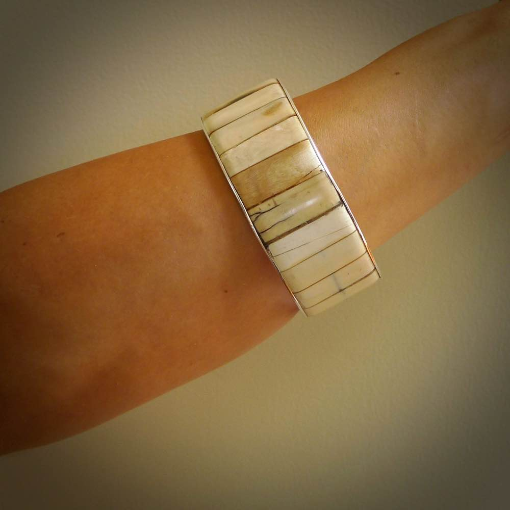 HAND MADE WOOLLY MAMMOTH TUSK WITH STERLING SILVER ARMBAND