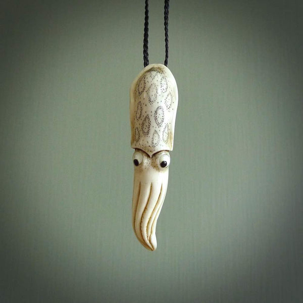 Hand carved squid pendant. This piece has been carved in minute detail from deer antler. The artist is Fumio Noguchi, a renowned New Zealand bone carver who carves pieces for NZ Pacific. These unique bone pendants are for sale online at nzpacific.com