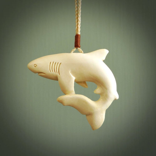 Hand carved mammoth tusk shark pendant. Great white shark pendant handmade from Woolly Mammoth. Made by NZ Pacific. Hand made jewellery for sale online.