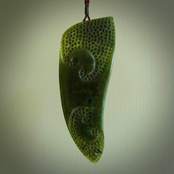 This piece is a large rei-puta pendant hand carved from New Zealand flower jade. It is large and ornately carved taking a traditional shape and adding some modern design. This is a marvellous piece that will become a collectors treasure.
