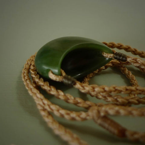 View from top and side of hand carved kete pouch jade pendant. Carved by New Zealand artist Brian Hill.