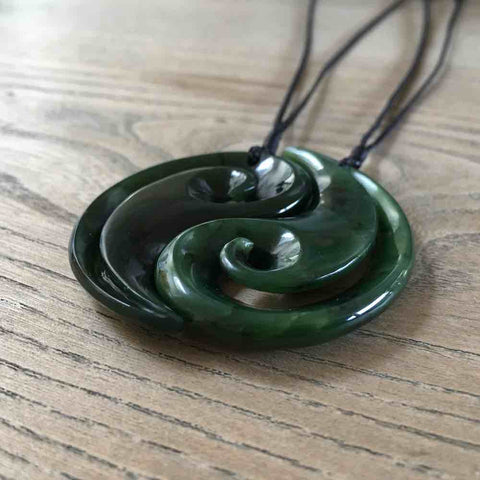 Jade koru pair pendant. Necklace hand carved in New Zealand jade by NZ Pacific.