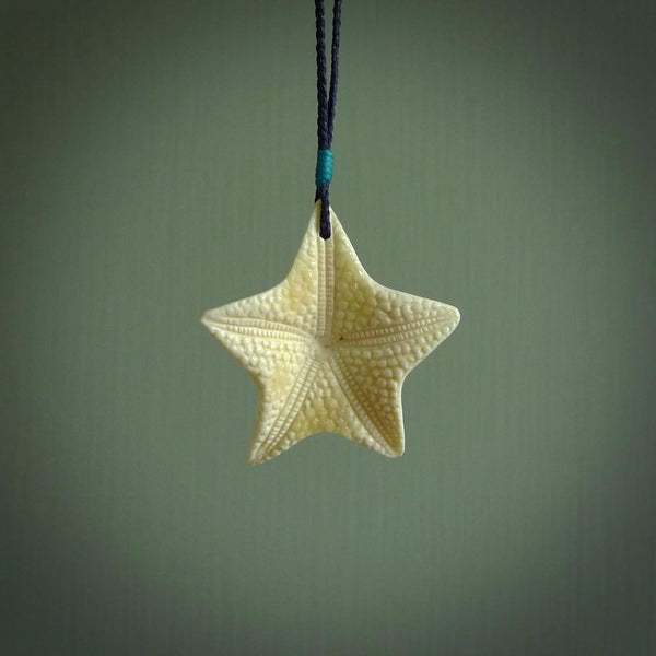 Hand carved bone starfish pendant. Ocean themed pendants carved by NZ Pacific. Moana pendants for sale online.