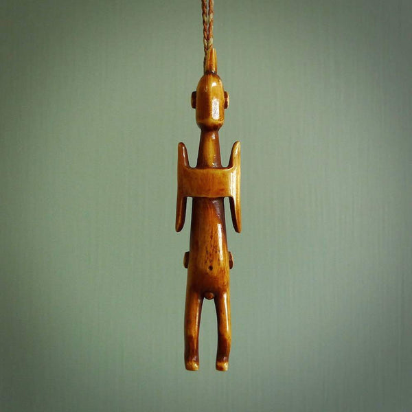 POKERFACE - a traditional Gambier Island figurine, carved as a pendant. This piece was hand carved for us by Yuri Terenyi. This is a work of art and is a collectable piece of traditional bone carving. It can be worn as a special piece of jewellery or displayed. This is art made to wear at its finest.