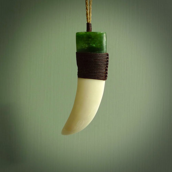Boars Tusk Pendant with a jade cap. Hand made pendant carved from a boars tusk. Hand made ethnic or maori jewellery for sale by NZ Pacific online.