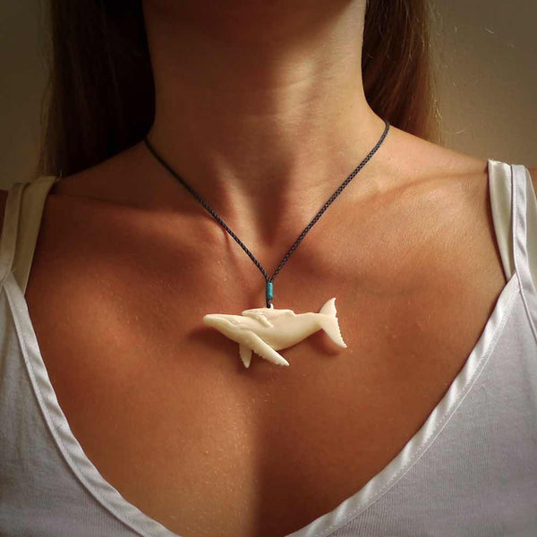 Hand carved bone whale pendant. Carved by NZ Pacific in natural bone. Hand made jewellery for sale online. A beautiful whale-themed pendant - Ocean Moana.