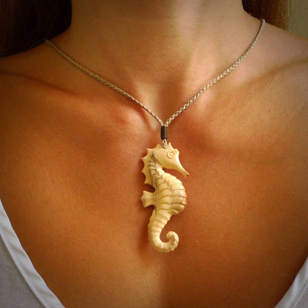 Hand carved woolly mammoth tusk seahorse pendant. Made by NZ Pacific.