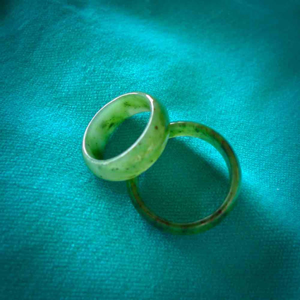 This is a handcarved jade ring. These are lovely dark jade pieces which are nice, solid little works of art. We ship these worldwide for free and are happy to answer any questions that you may have about these or other products on our website.