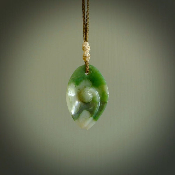 Hand carved jade koru pendant. Carved by NZ Pacific and for sale online. Gorgeous and unique jade jewellery.