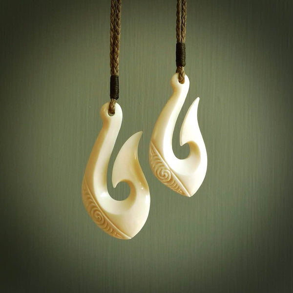 Hand carved engraved bone hook pendant. Made in New Zealand by NZ Pacific.