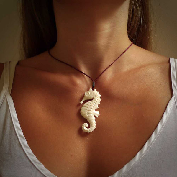 Hand carved seahorse pendant. Hand made from natural bone by NZ Pacific. Handcrafted, unique jewellery for sale online.