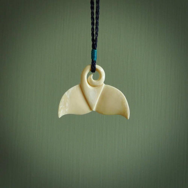 Hand carved whale tail pendant. Carved from woolly mammoth tusk in 10,000 year old mammoth tusk. A rare and original handmade pendant for ocean lovers.