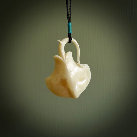 Hand carved stingray pendant. Natural bone pendants from NZ Pacific.