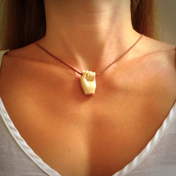 Hand carved pendant symbolising strength and hope - Shown worn. Carved by NZ Pacific from ancient woolly mammoth tusk. Unique jewellery for sale online.