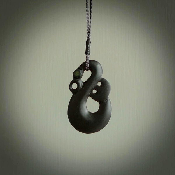Hand carved basalt stone manaia pendant. Maori pendant hand carved in New Zealand. Ethnic art jewellery.