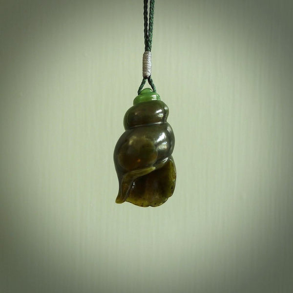 Snail design pendant carved in nephrite jade. Real jade jewellery for sale online with NZ Pacific.