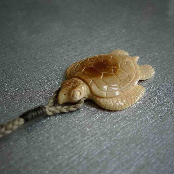 Hand carved woolly mammoth tusk turtle pendant.