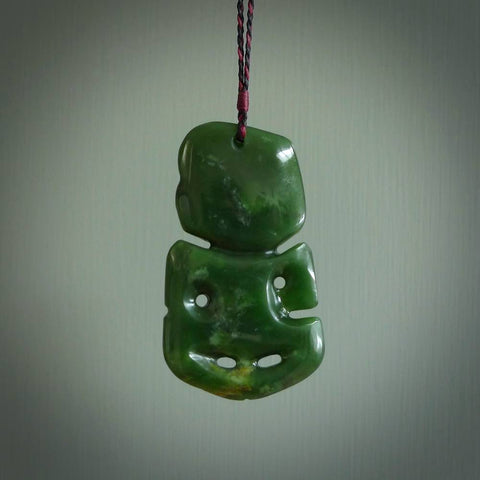 Hand carved flower jade toki pendant, with koru heart. Carved by Ross Crump for NZ Pacific.