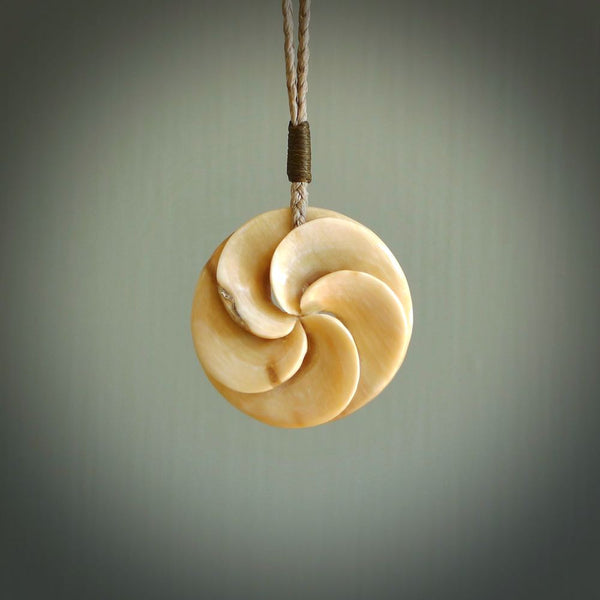 Hand carved woolly mammoth tusk, koru shaped pendant. Hand made by NZ Pacific. Handmade jewellery.