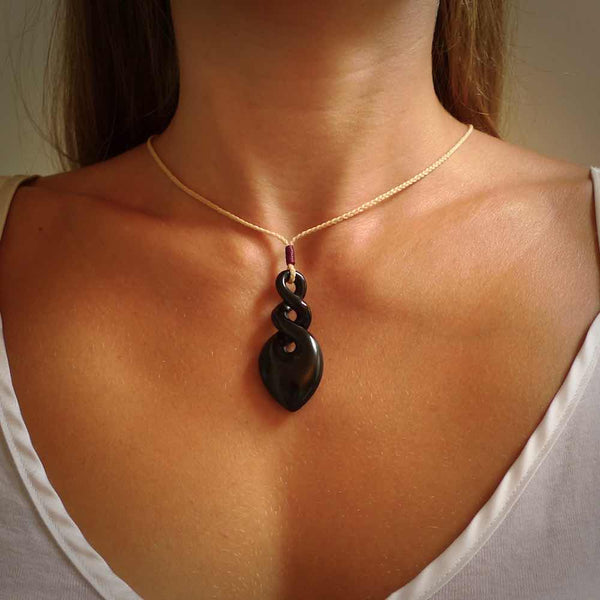 Hand carved Black Jade twist pendant. Made by NZ Pacific.