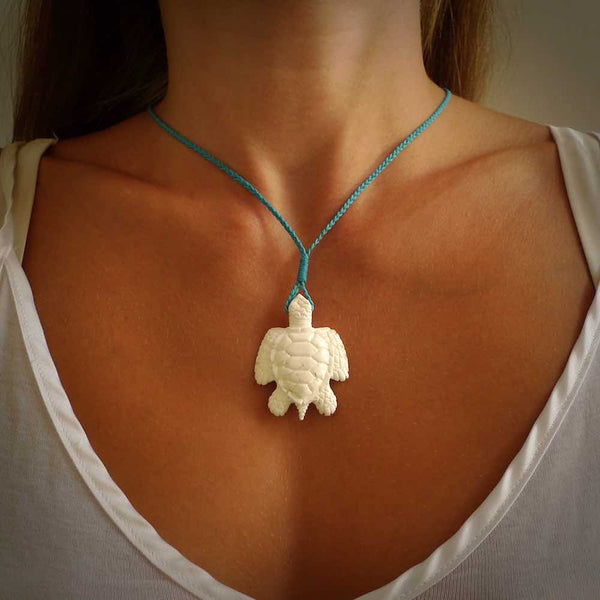 Hand carved white onyx turtle pendant. Unique handmade jewellery for sale online. Carved by NZ Pacific - moana jewellery.