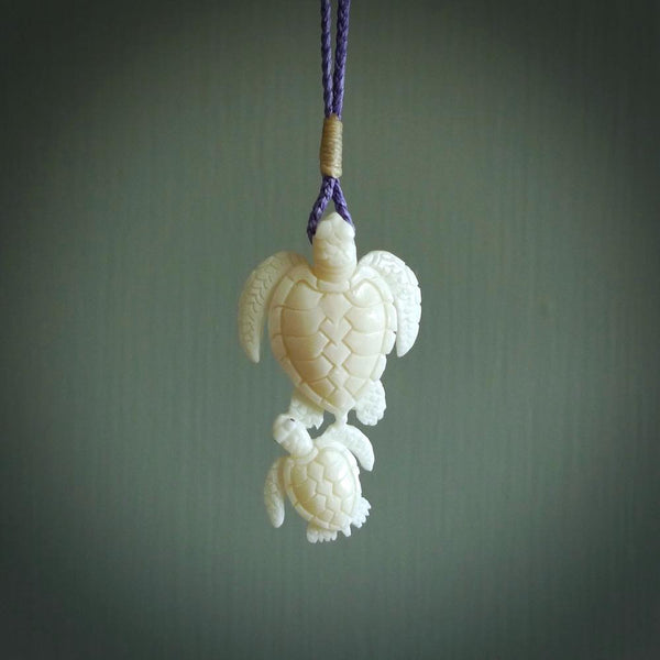 Pair of turtles hand carved in bone. Hand carved jewellery made by NZ Pacific and for sale online. Moana jewellery, handcarved in bone.