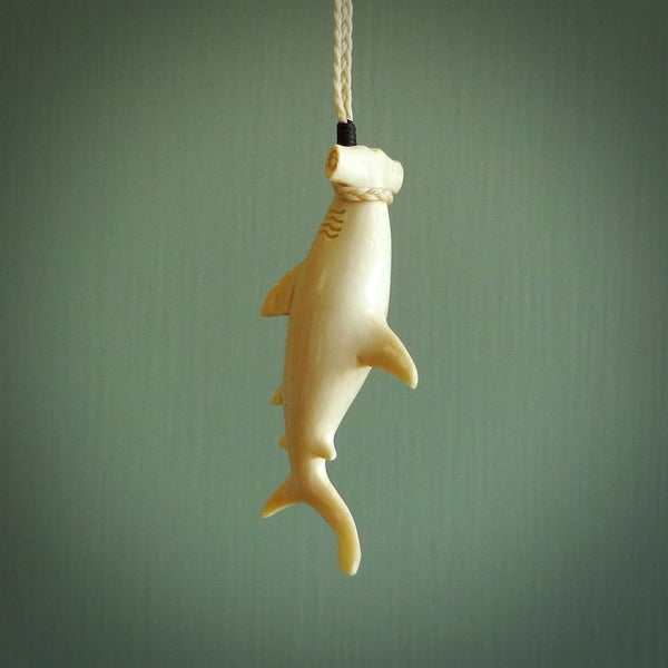Hand carved hammerhead shark pendant. Carved by NZ Pacific for ocean lovers. Hand crafted jewellery for sale online. Pendants handcarved from natural materials.