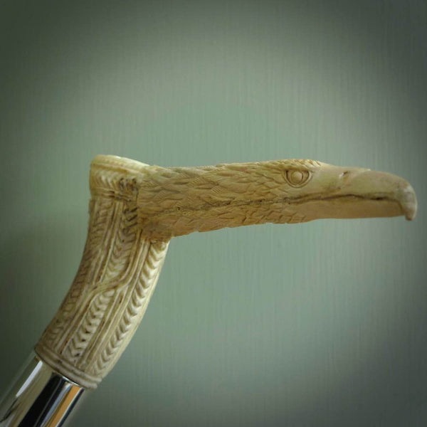 Hand carved walking stick. Traditional hand carved walking cane made from deer antler, buffalo horn, wood and sterling silver. Hand made art for sale online by NZ Pacific.