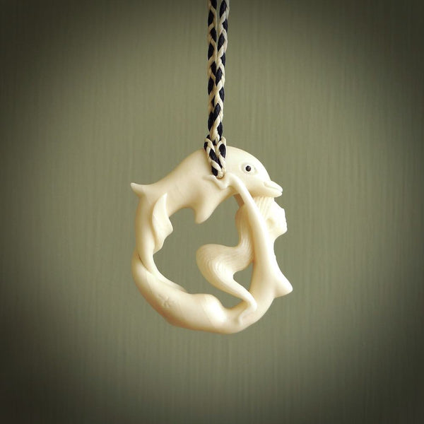 This pendant is a gorgeous and intricately carved mermaid with dolphin pendant. Carved by renowned bone carver Yuri Terenyi for us. This is a little masterpiece. It is a mermaid with her arms clasped around a dolphin. The craftsmanship displayed in this piece is extraordinary - a collectors item, or a piece to wear and love.