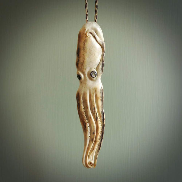 Hand carved octopus pendant. This piece has been carved in minute detail from deer antler. The artist is Fumio Noguchi, a renowned New Zealand bone carver who carves pieces for NZ Pacific. These unique bone pendants are for sale online at nzpacific.com One only collectors item for lovers of the ocean and octopus.