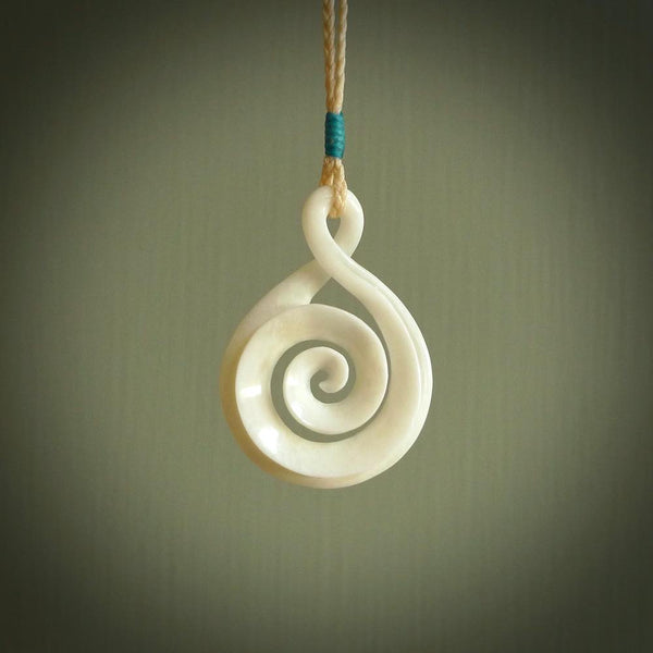 Hand carved bone twist with koru pendant. Real natural bone. These are suspended on a length adjustable plaited cord.