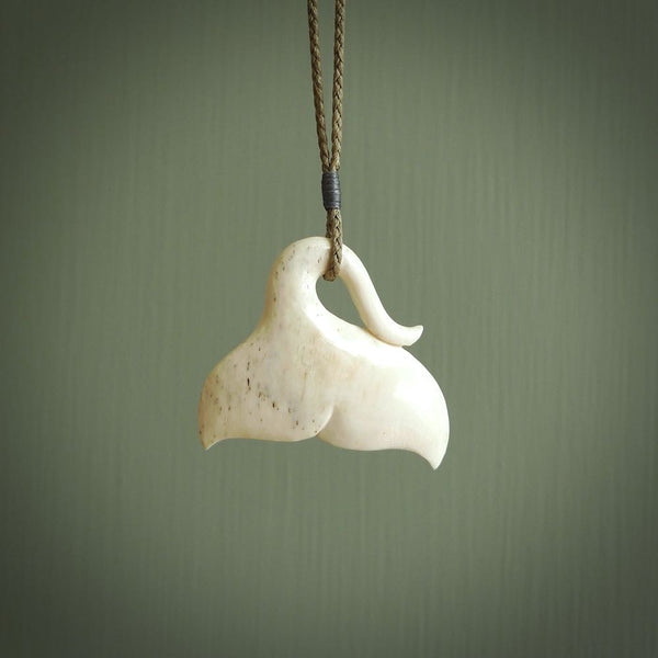 Hand carved bone whale tail pendant. Made by NZ Pacific.