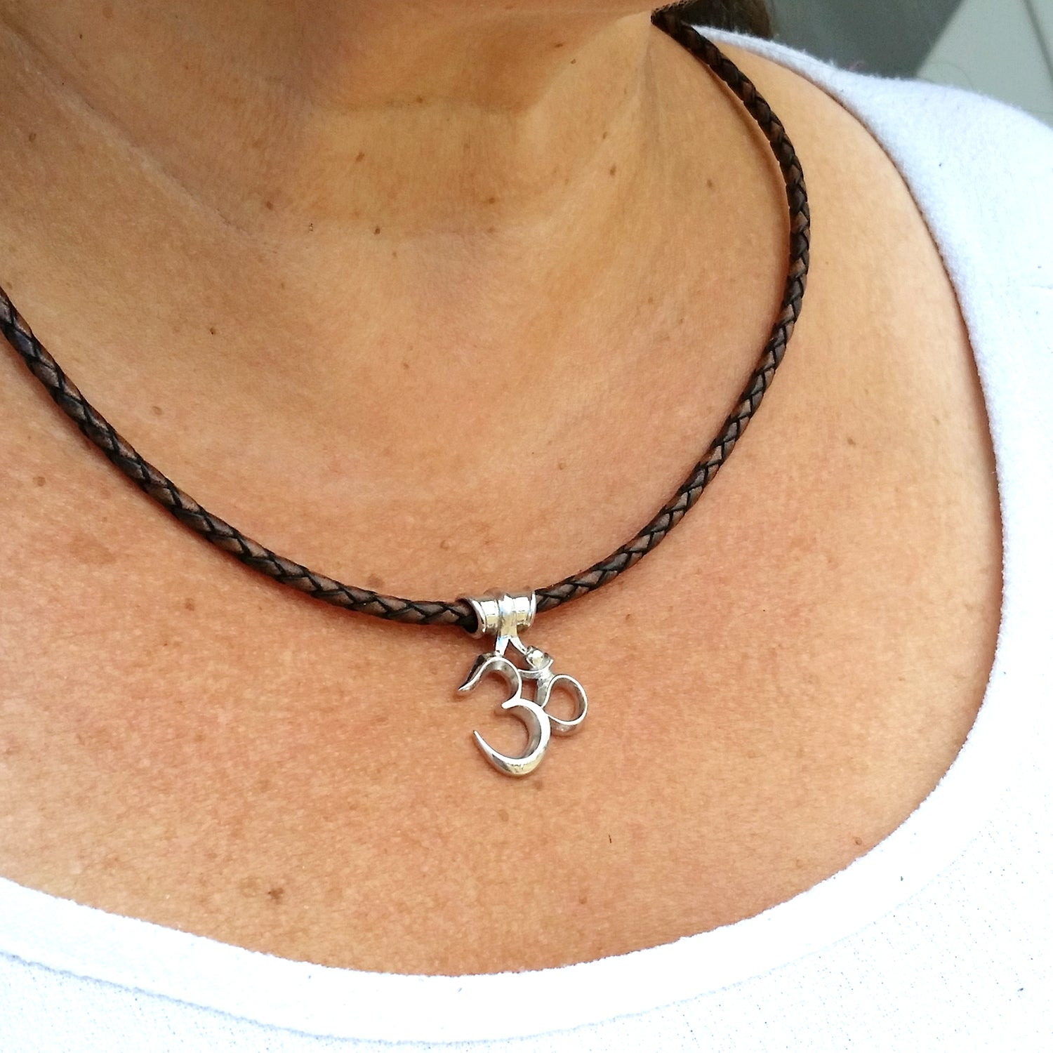 Om Necklace on Braided Cord