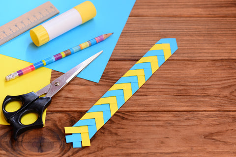 Creating a paper bookmark encourages children to embrace reading