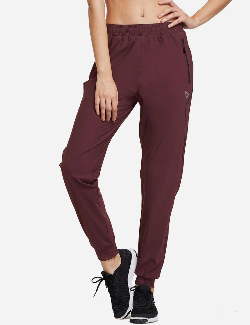 Baleaf Womens Evo Mid Rise Seamless Lightweight Mesh Paneled Cuffed Track Pants Dark Red Front