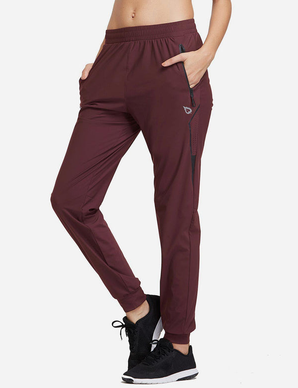 Baleaf Womens Evo Mid Rise Seamless Lightweight Mesh Paneled Cuffed Track Pants Dark Red Side