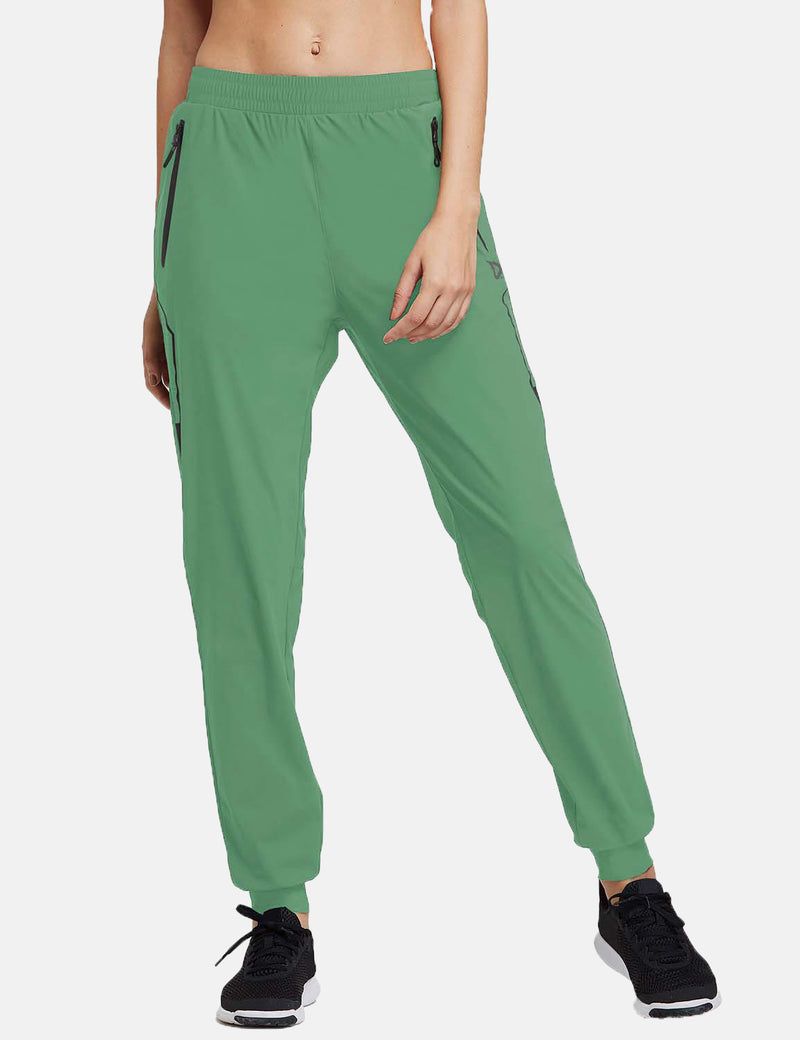 Baleaf Womens Evo Mid Rise Seamless Lightweight Mesh Paneled Cuffed Track Pants Light Green Front