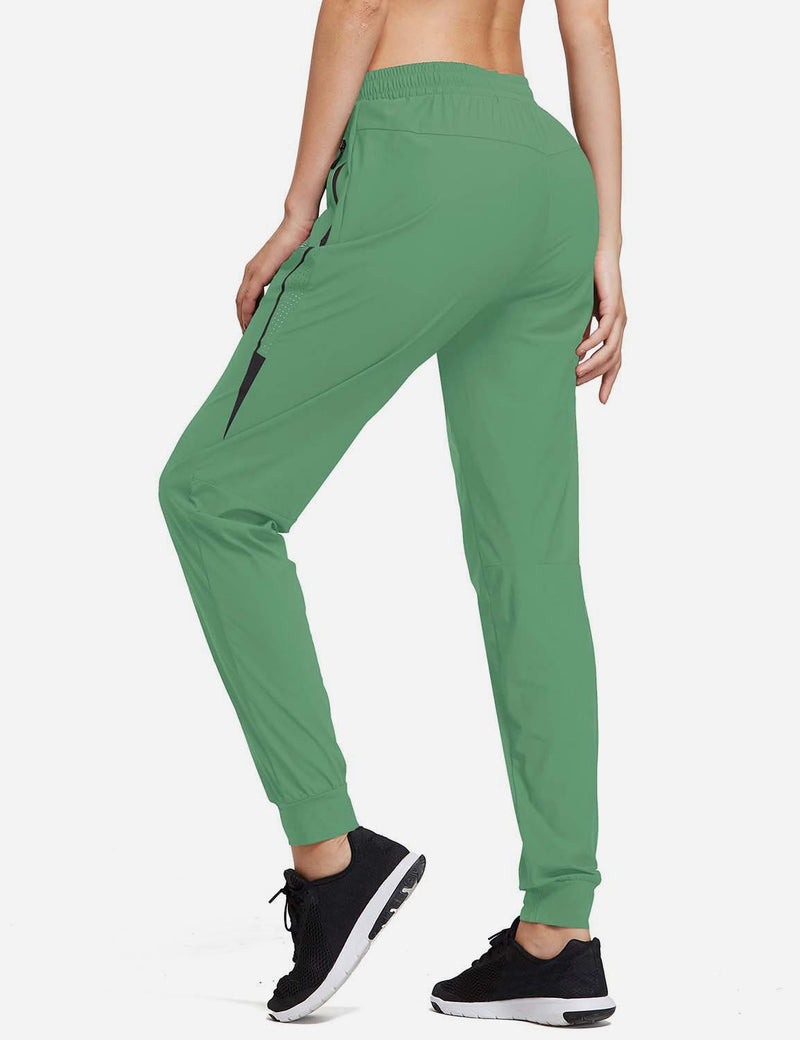 Baleaf Womens Evo Mid Rise Seamless Lightweight Mesh Paneled Cuffed Track Pants Light Green Back