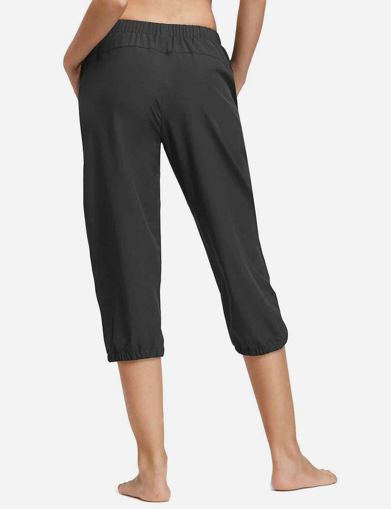 Baleaf Womens Woven UPF 50+ Tapered Capris black back