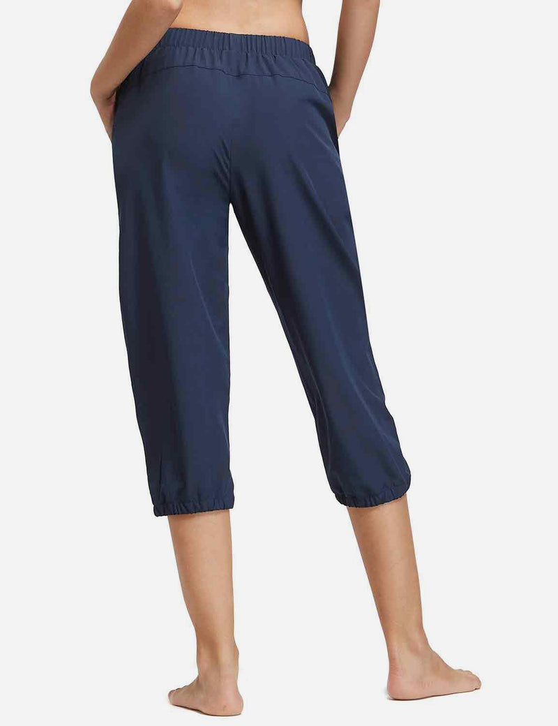 Baleaf Womens Woven UPF 50+ Tapered Capris navy back