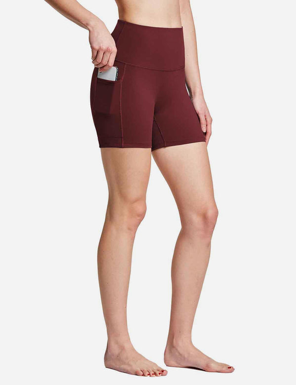 Baleaf Womens 4'' High Rise Tummy Control Yoga Shorts w Side Pockets Wine Red front